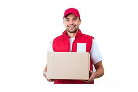 Delivery service worker in uniform delivering parcel. Man with box smiling and looking at camera